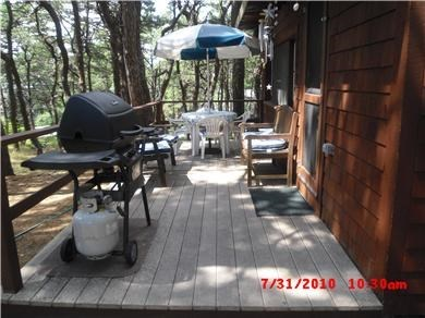 Wellfleet Cape Cod vacation rental - Deck with grill and seating.
