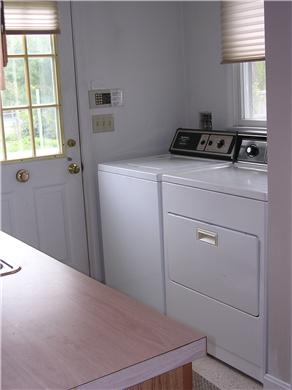 Centerville Centerville vacation rental - Washer/Dryer and bar area with additional sink off kitchen