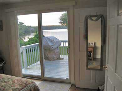 Plymouth MA vacation rental - Master bedroom with slider to deck overlooking pond