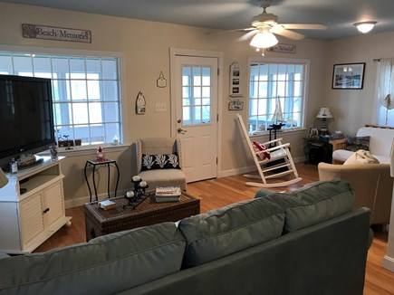 West Dennis Cape Cod vacation rental - Sunny living room layout, featuring bamboo floors.