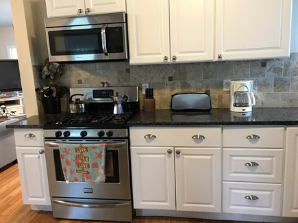 West Dennis Cape Cod vacation rental - Remodeled kitchen with grainte and stainless steel appliances.