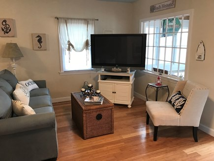 West Dennis Cape Cod vacation rental - Cozy beach themed living room with lots of sunlight.