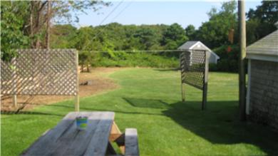 South Yarmouth Cape Cod vacation rental - Enlarged back yard - great for kids and games!