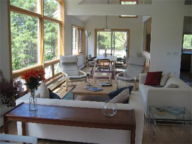 So.Wellfleet Cape Cod vacation rental - Living and dining area; glass doors to 2nd floor deck