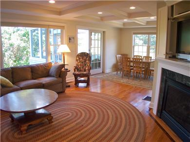 Brewster Cape Cod vacation rental - LR has big flat screen TV, gas fireplace, walks out to porch