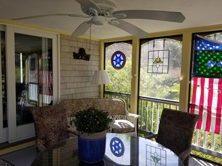 Wellfleet  Cape Cod vacation rental - Screened porch with dining area & couch for reading and relaxing