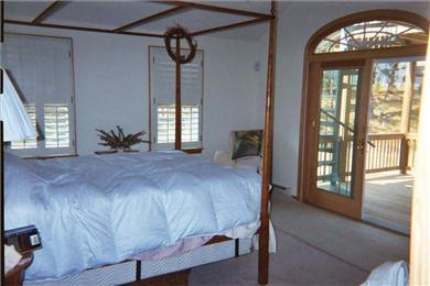 Wellfleet Cape Cod vacation rental - Master bedroom, canopy queen bed, access to upper decks