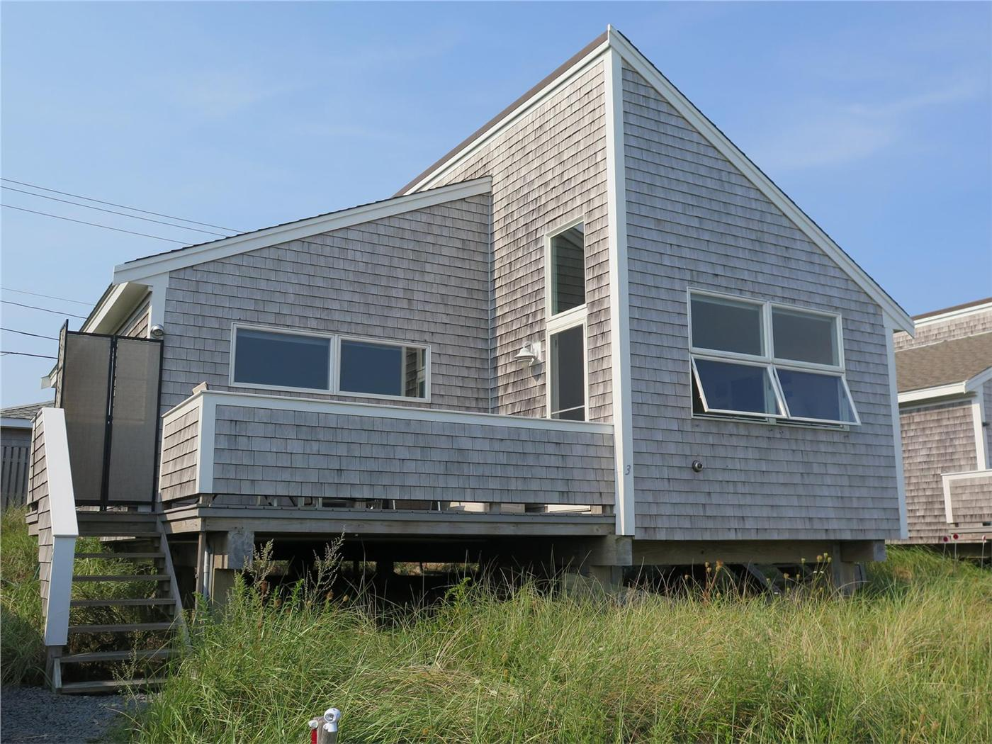 provincetown cottage cape seashore on weathered stock with garden flower national street photo ma in cod commercial s cottages