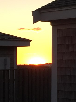 Beach Point, North Truro Cape Cod vacation rental - Sunset over Provincetown from kitchen landing.