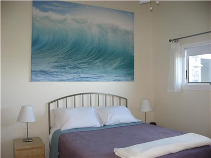 Beach Point, North Truro Cape Cod vacation rental - Queen bedroom: ceiling fan, view of lake and dunes
