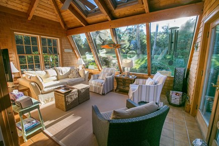 Brewster Cape Cod vacation rental - Sunroom with TV open to kitchen.