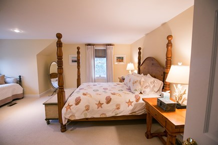 Brewster Cape Cod vacation rental - Family suite bedroom sleeps 5. Queen and 3 twins. View of pond.
