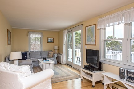 South Wellfleet Cape Cod vacation rental - Living room with access to the deck