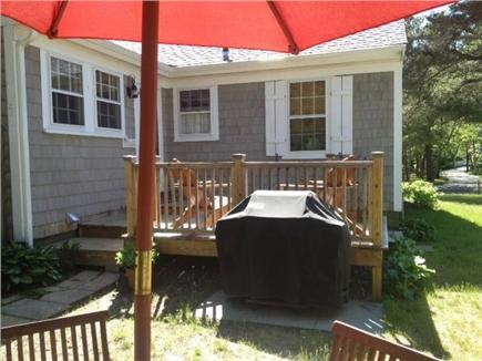 West Harwich Cape Cod vacation rental - A sunny deck and adirondack chairs for morning coffee