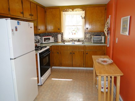 South Dennis Cape Cod vacation rental - Kitchen with door to the back yard