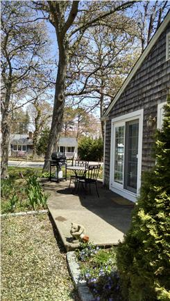South Dennis Cape Cod vacation rental - Grill and sitting area on side of the house