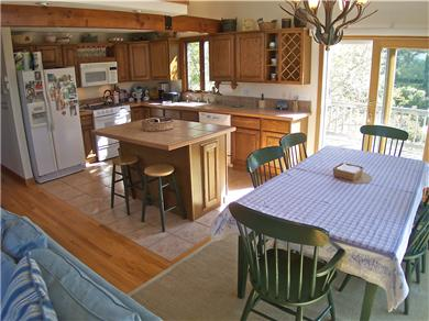 Brewster Cape Cod vacation rental - Kitchen and dining area walk out to rear deck, table, gas grill
