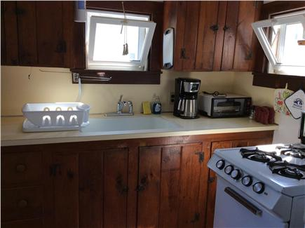 Dennis Port Cape Cod vacation rental - Kitchen with back door to deck area.