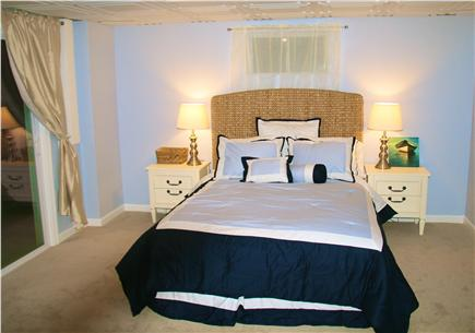 Brewster Cape Cod vacation rental - Finished basement bedroom with Queen size bed, Laundry, TV room