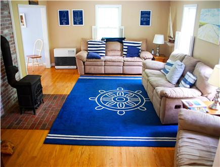 Brewster Cape Cod vacation rental - Living Room with Reclining Sofas, Flat Screen TV, and Wood Stove