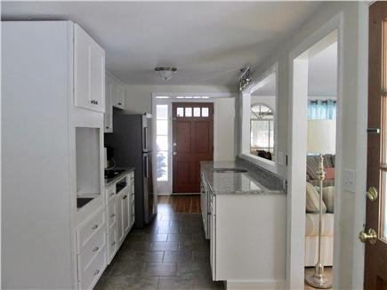 South Yarmouth Cape Cod vacation rental - Kitchen with new cabinets, appliances, and granite countertops.