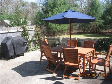 South Yarmouth Cape Cod vacation rental - Spacious fenced in patio overlooks large private backyard.