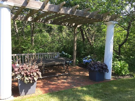 South Truro Cape Cod vacation rental - Pergola with table and bench.