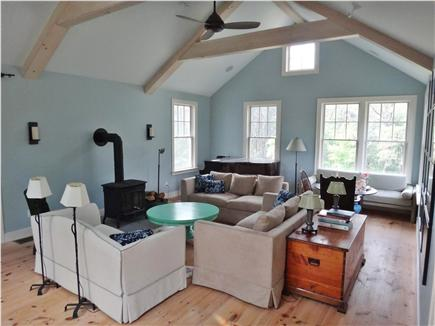 South Truro Cape Cod vacation rental - Living room has light from 4 directions, plus piano & wood stove.