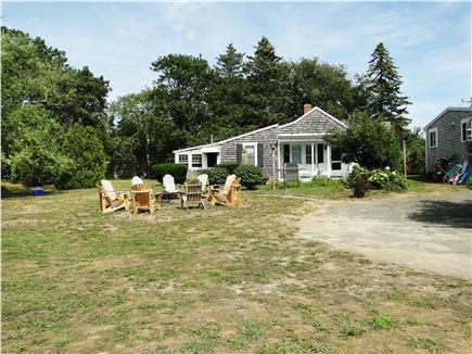 Dennis Port Cape Cod vacation rental - Large backyard to play, ride bikes, privacy, safety