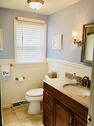 Harwich Cape Cod vacation rental - Beachy bath with travertine floor and tub and shower.