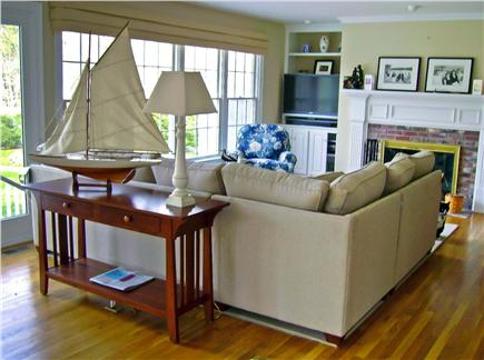 East Harwich Cape Cod vacation rental - The living room/entertainment area has windows facing the back