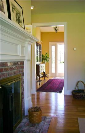 East Harwich Cape Cod vacation rental - The entrance hall and fireplace.