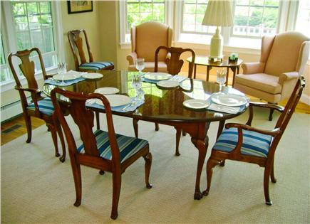 East Harwich Cape Cod vacation rental - The dining room with bay window at back, facing yard and pool