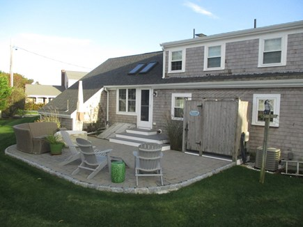 South Yarmouth Cape Cod vacation rental - Rear yard with patio, shower, and clothesline