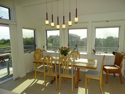 N.Truro Bay Village Cape Cod vacation rental - Dining area faces water views, seats 8