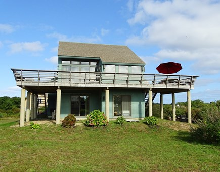 N.Truro Bay Village Cape Cod vacation rental - Back of house, showing large deck, many sliders