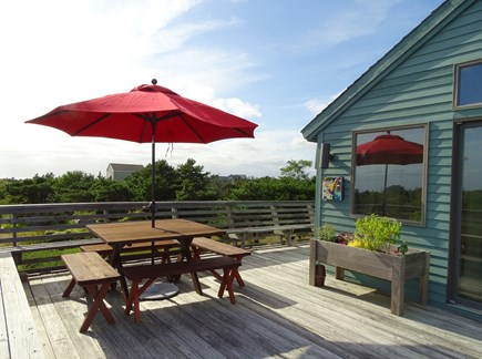 N.Truro Bay Village Cape Cod vacation rental - Deck area with two major seating areas, water views