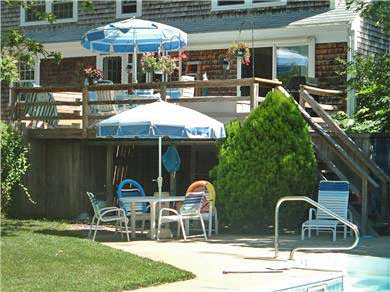 East Orleans Cape Cod vacation rental - Pool area and deck on back side of house