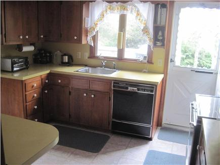 East Orleans Cape Cod vacation rental - Kitchen with door to deck and opening to dining room to left