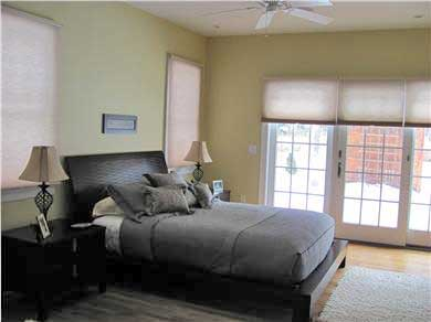 North Falmouth Cape Cod vacation rental - Mstr. Bedroom with sliders to landscaped patio & tennis court