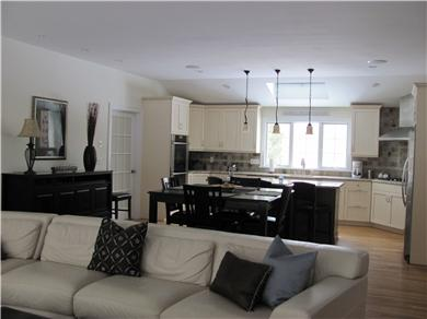 North Falmouth Cape Cod vacation rental - Family, dining, and kitchen area w/beautiful leather sectional