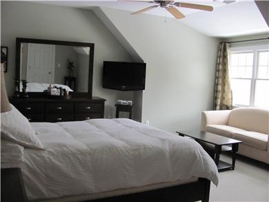 North Falmouth Cape Cod vacation rental - One of 10 bedrooms. Sofa w/sitting area, HD plasma TV