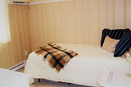 Harwichport, MA Cape Cod vacation rental - well lit backyard Bedroom three, twin bed, tv, ac,