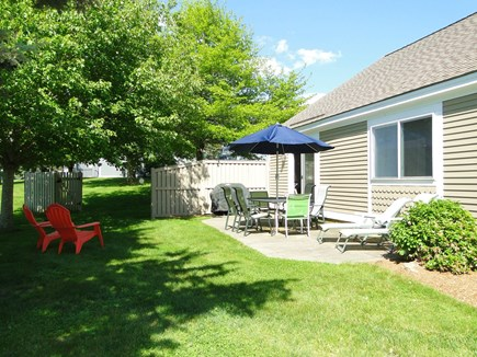 Brewster Cape Cod vacation rental - Back patio w/BBQ grill and seating area