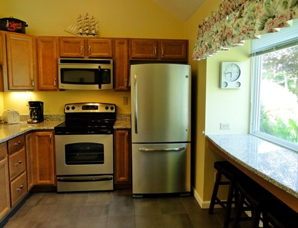 Brewster Cape Cod vacation rental - Recently updated kitchen with breakfast bar