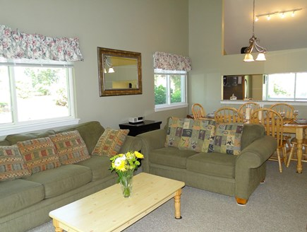 Brewster Cape Cod vacation rental - Open and vaulted living room with TV and dining area