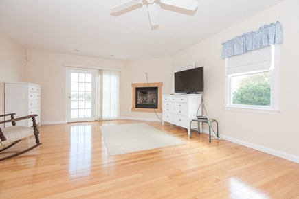 Bourne, Buzzards Bay Cape Cod vacation rental - View 2 of upstairs bedroom (gas fireplace and balcony)