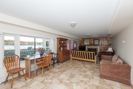 Bourne, Buzzards Bay Cape Cod vacation rental - Living/dining area of lower level with water views