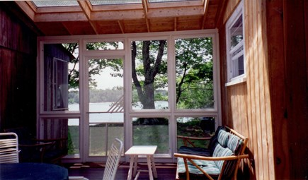 Ashumet Pond, Mashpee Cape Cod vacation rental - Screened porch with view toward the lake