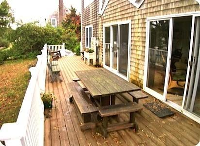 Brewster Cape Cod vacation rental - House-wide front deck adds still more outdoor living space.